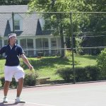 Tennis player serving on the courts