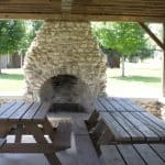 Edgewood park fireplace and picnic tables